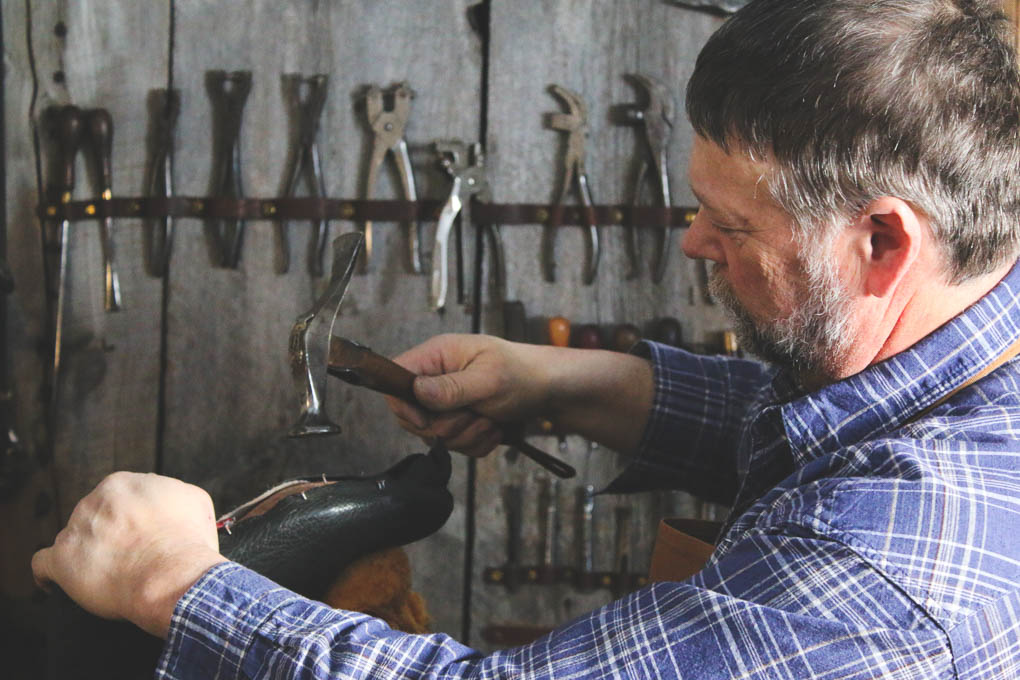 Photo Wade Cashman working on leather boots for website